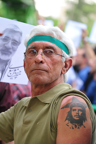 Demonstrator displays socialist tattoo. by John Edmundson