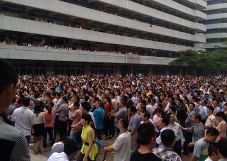 Class polarisation: 30,000 workers on strike at China's biggest shoe factory in 2014.